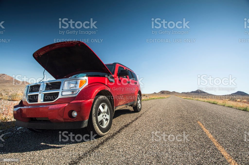 Car with the hood open on the side of the salt flats in Utah USA stock photo