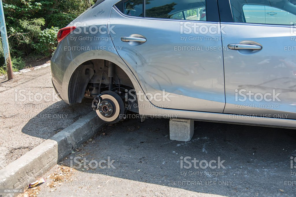 Car with without wheels stock photo