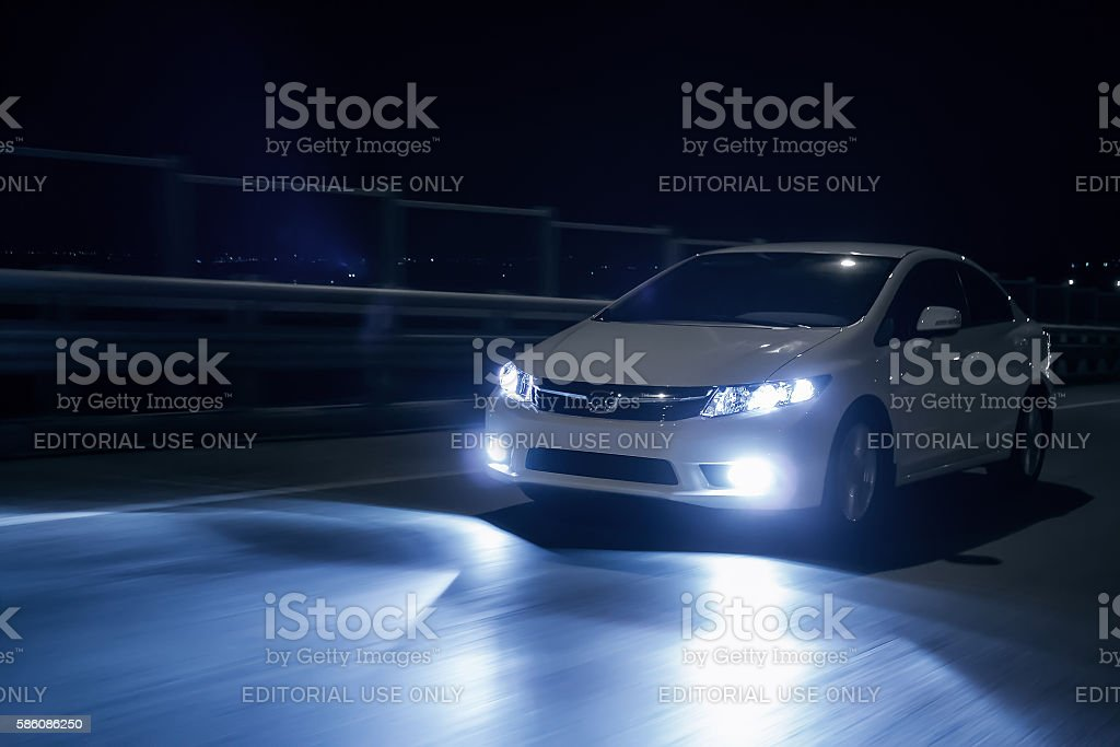 Car with xenon headlights fast drive on road at nigh stock photo