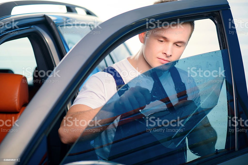 Car wrapping specialist in the station stock photo