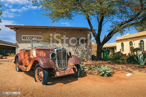 Solitaire, Namibia - March 29, 2019 : Car wreck at the Solitaire Lodge in Namibia. Solitaire is a small settlement in the namibian desert near the Namib-Naukluft National Park.