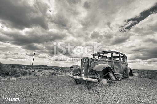 Car Wreck in USA. The photo was taken with the HDR technique which combines photos taken at different exposure and blended together. The photo was then converted to black and white and toned differently for highlight and shadows. A vignetting was added to balance the composition.