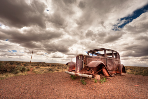 Car Wreck in USA. The photo was taken with the HDR technique which combines photos taken at different exposure and blended together. The photo was then desaturated and toned. A vignetting was added to balance the composition.