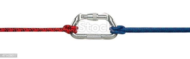 This is a photo taken in the studio of a red and blue climbing rope attached to a carabiner with a clove hitch knot on each end isolated on a white background. There is a clipping path included with this file.
