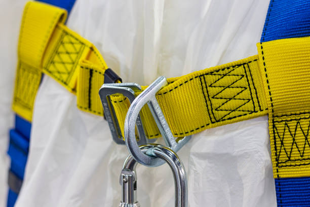 carabiner for climbing harness - fall prevention stock photos and pictures