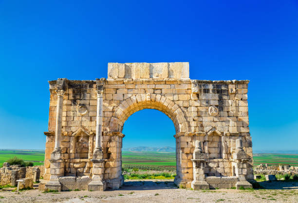 Caracalla Triumphal Arch at Volubilis, a UNESCO heritage site in Morocco Caracalla Triumphal Arch at Volubilis, a UNESCO world heritage site in Morocco arch architectural feature stock pictures, royalty-free photos & images