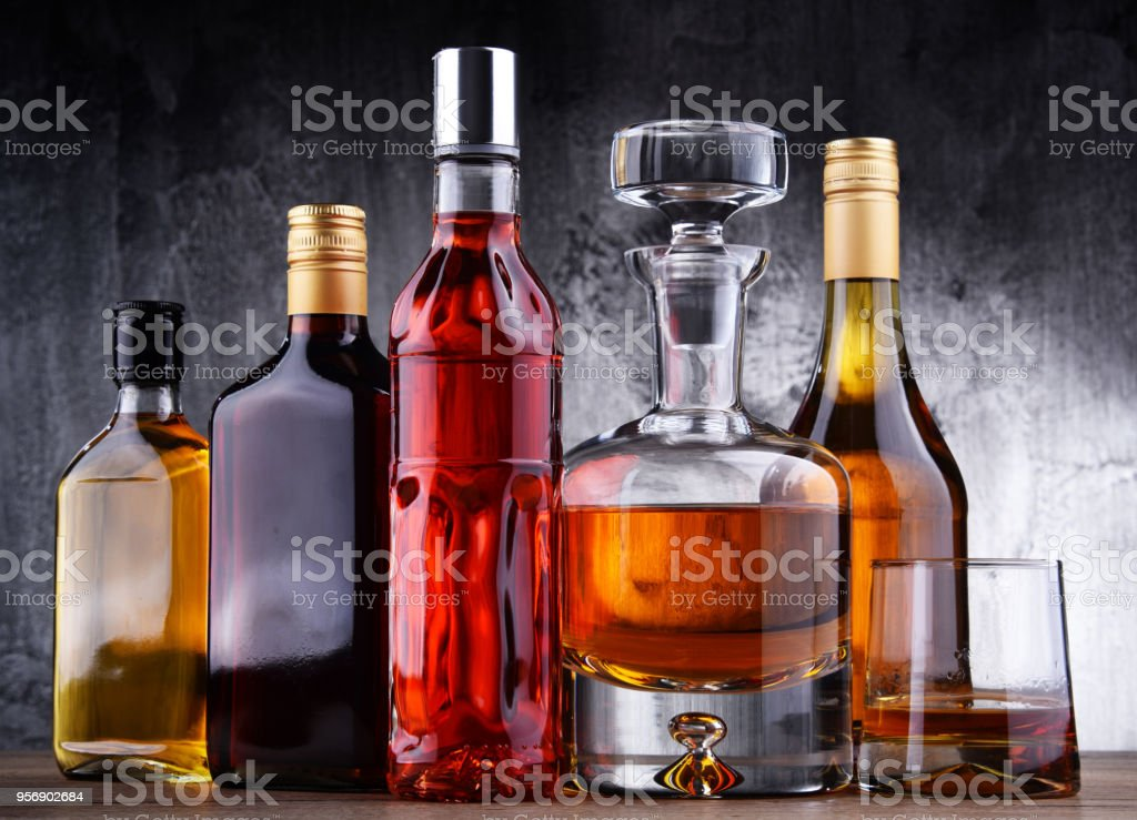 Carafe and bottles of assorted alcoholic beverages. stock photo