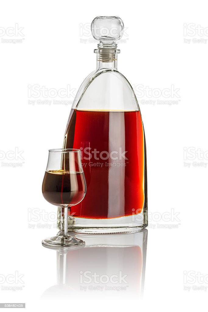Carafe and snifter filled with brown liquid stock photo