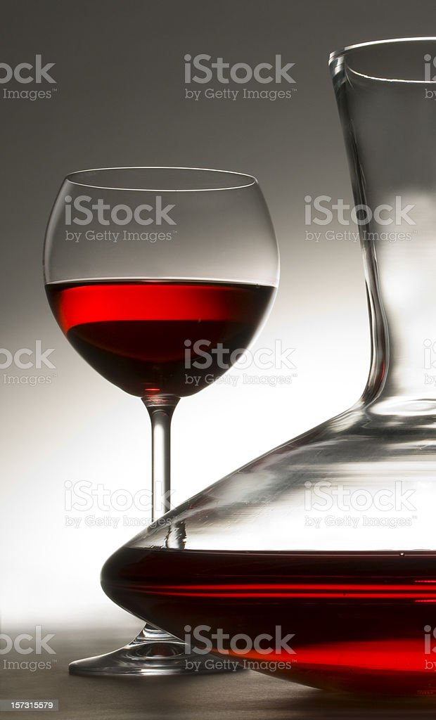carafe of red wine with wineglass stock photo