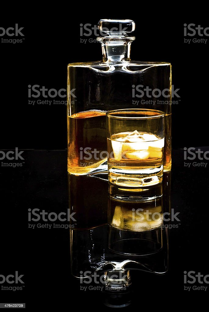 carafe of scotch whiskey or bourbon and drink with ice royalty-free stock photo