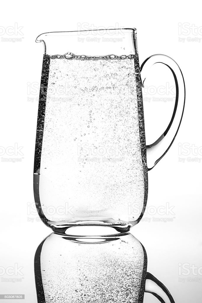 Carafe of sparkling mineral water stock photo