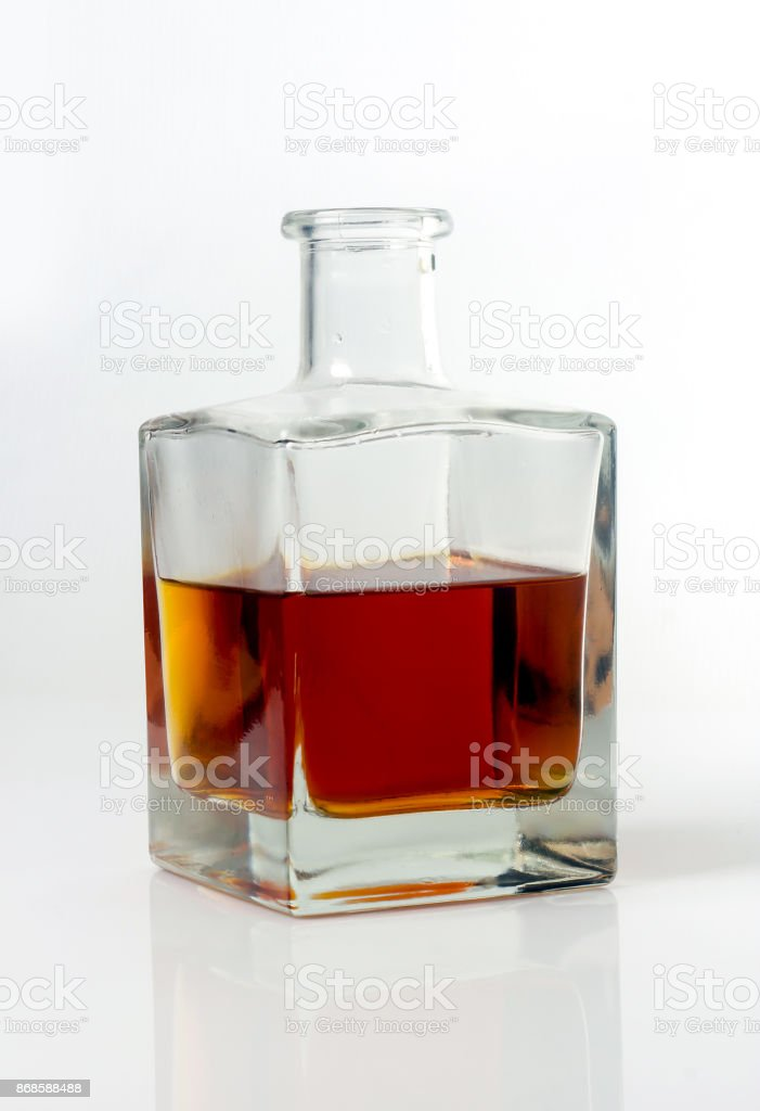 carafe with whiskey on white background stock photo