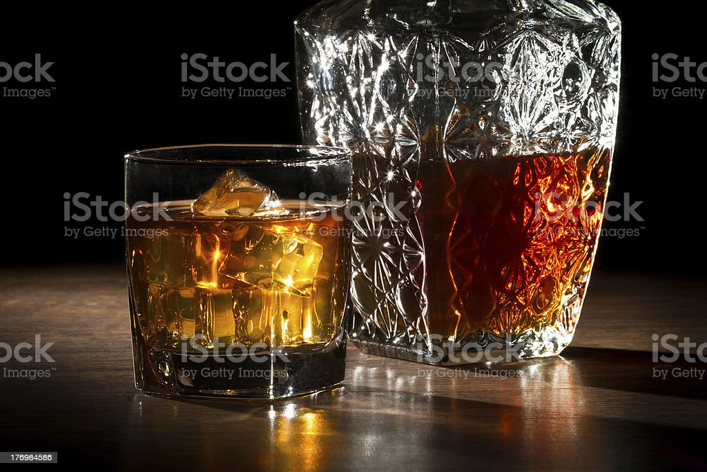 Carafer, glass with ice and whisky royalty-free stock photo