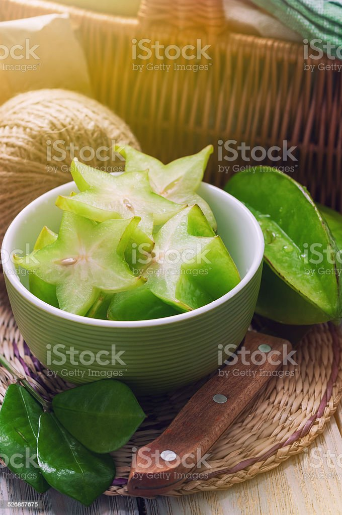 carambola slices in a green plate stock photo