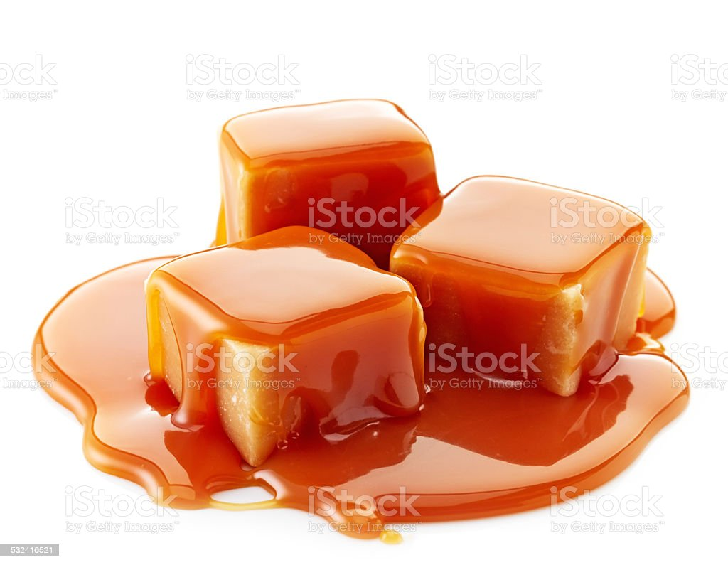 caramel candies and caramel sauce stock photo