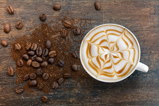 Caramel cappuccino with ground top view.