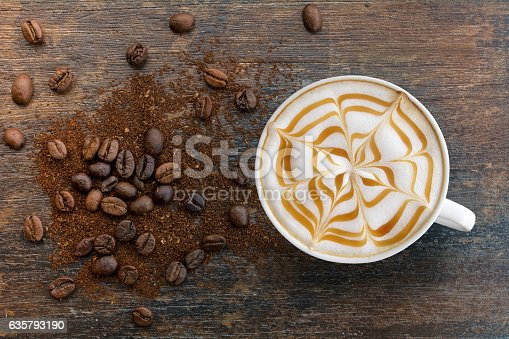 istock Caramel cappuccino with ground top view. 635793190