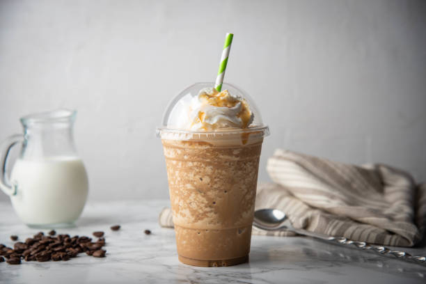 caramel frappuccino with wipped cream on marble table stock photo