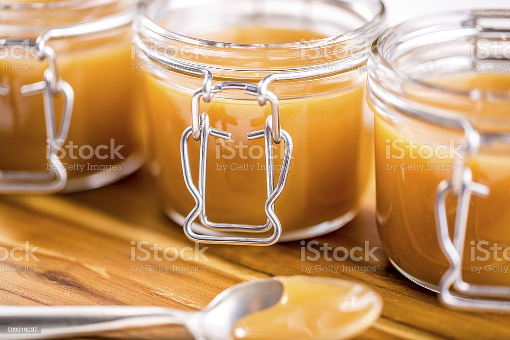 Caramel in jars stock photo