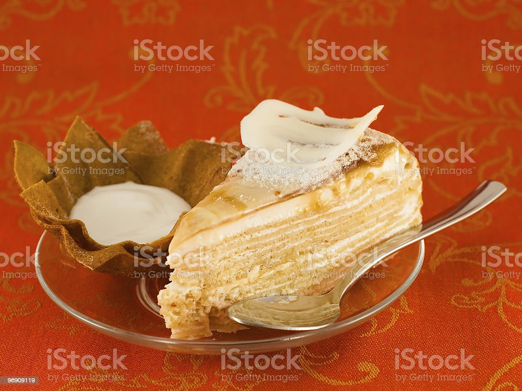 Caramel layer cake decorated with white chocolate royalty-free stock photo