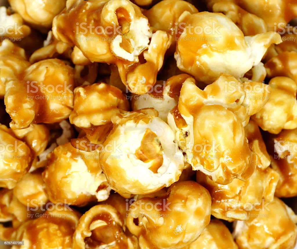Caramel popcorn background close up stock photo