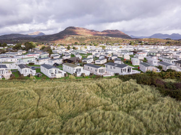 Caravan and camping, static home aerial view Porthmadog holiday park taken from the air by a drone trailer park stock pictures, royalty-free photos & images