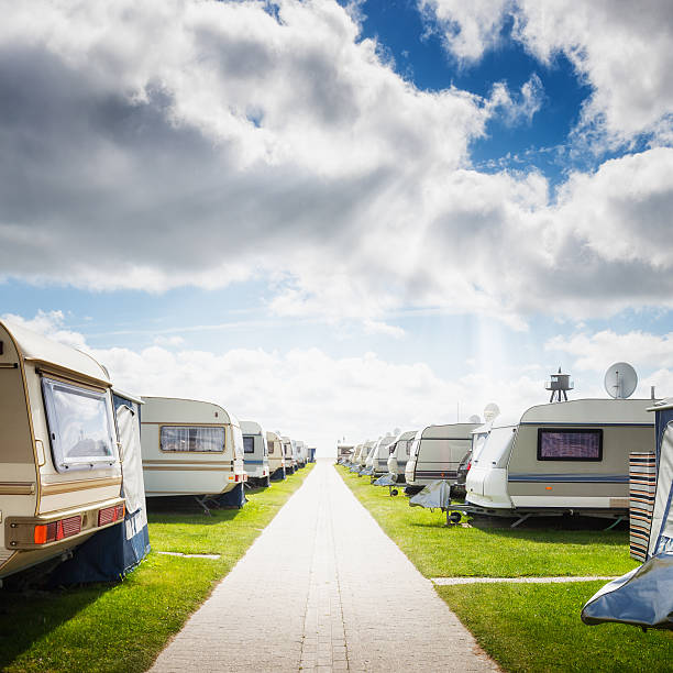 Caravan camping Caravan camping on the beach. Family vacation. North sea coast, Germany trailer park stock pictures, royalty-free photos & images