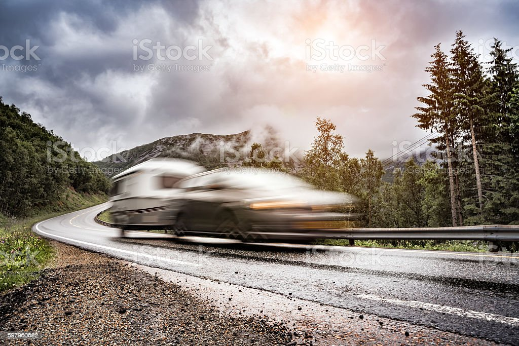 Caravan car trailer travels on the highway. stock photo