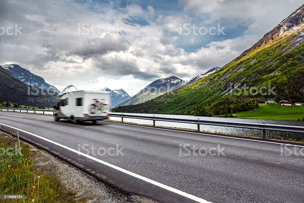 Caravan car travels on the highway. stock photo