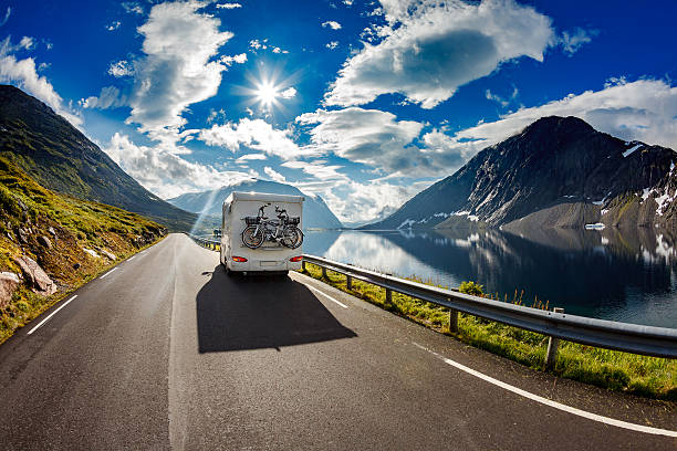 caravan car travels on the highway. - caravan stockfoto's en -beelden