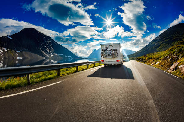 caravan car travels on the highway. - motorhome stock photos and pictures