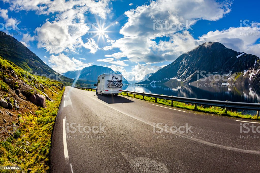 Caravan car travels on the highway. foto stock royalty-free