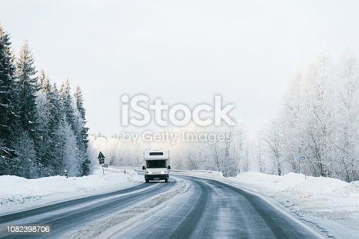 Caravan in a road at winter Rovaniemi, in Lapland in Finland. At snowfall