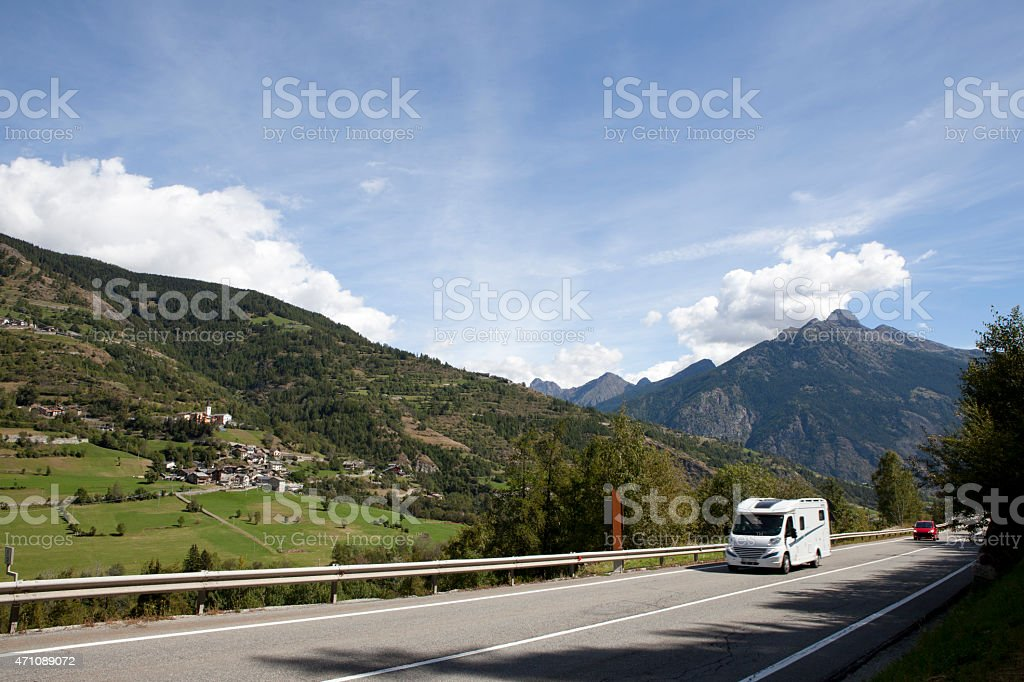 Caravan in the Alps stock photo