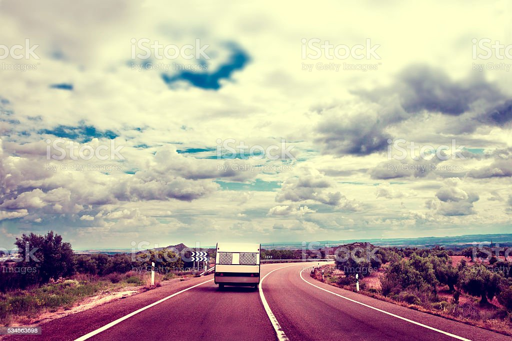 Caravan lifestyle road and landscape in vintage old style. stock photo