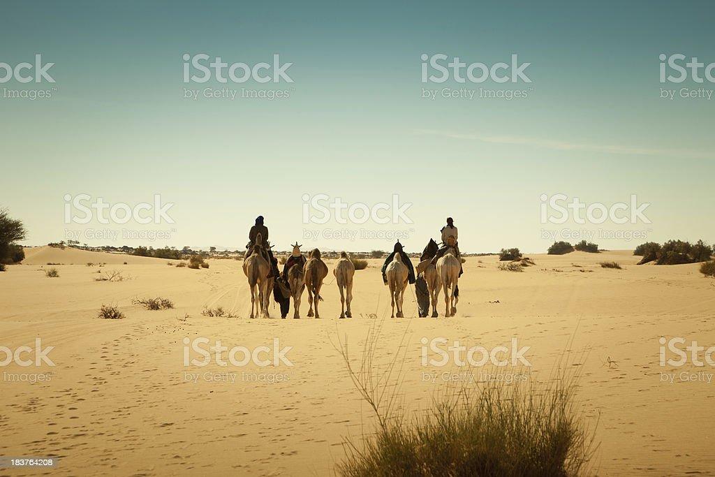 Caravan of travelers in Libyan Sahara desert royalty-free stock photo
