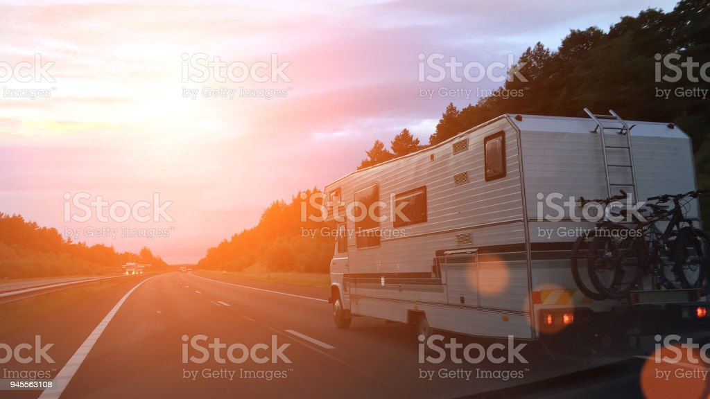 Caravan on the road stock photo