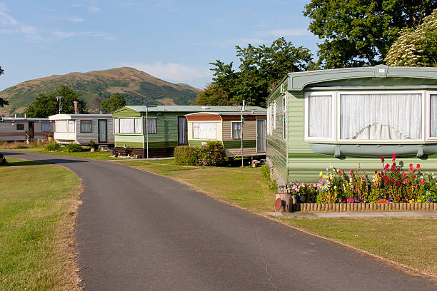 Caravan site set in rural Wales Static caravans parked on a pretty caravan site in rural Wales with mountains as a back drop. trailer park stock pictures, royalty-free photos & images