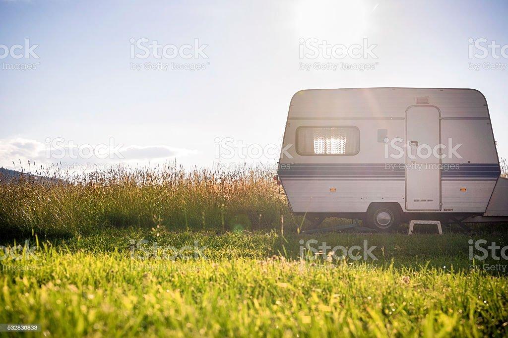 Caravan trailer on rural sunny setting stock photo