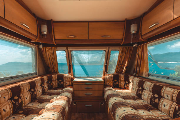 Caravan trailer with sea view, view from the inside, point of view shot. Road adventure Caravan trailer with sea view, view from the inside, point of view shot. Road trip adventure rv interior stock pictures, royalty-free photos & images