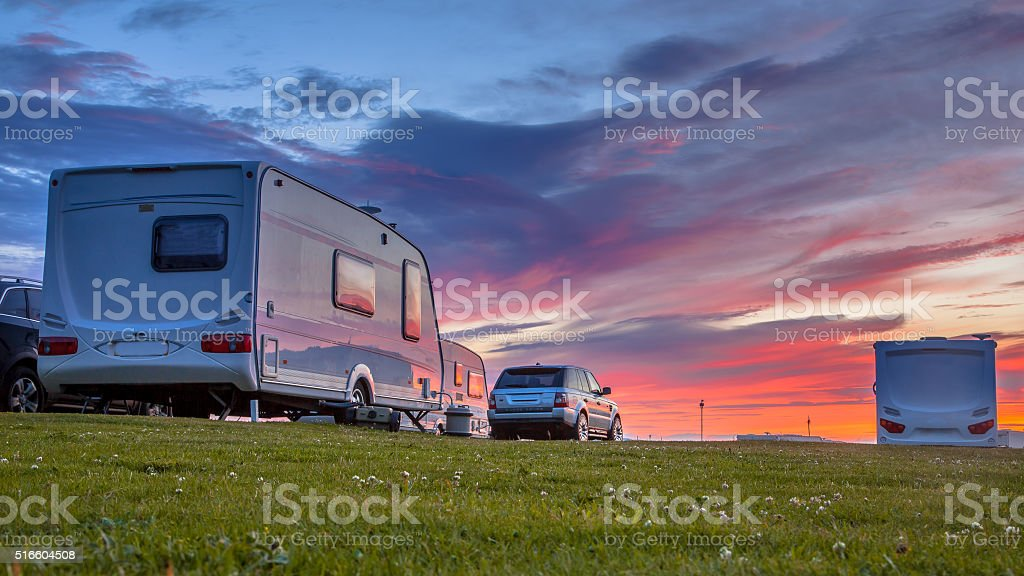 Caravans and cars  sunset stock photo