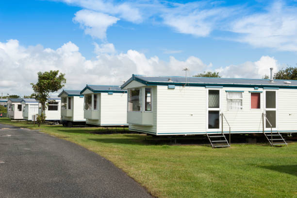 Caravans in a row Caravan park in the South of England. trailer park stock pictures, royalty-free photos & images