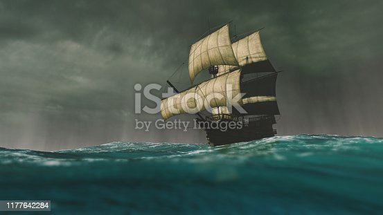 istock Caravel sailing the ocean during a storm 1177642284