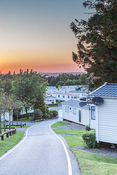 Caravnan Park Caravan park at sunset in the UK manufactured housing stock pictures, royalty-free photos & images