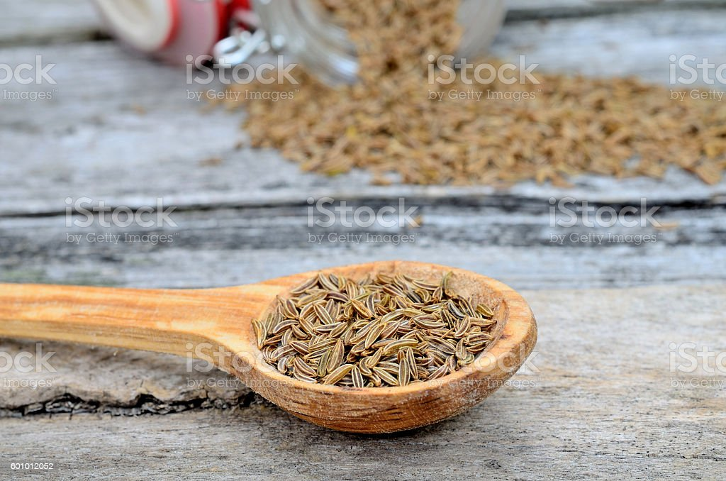caraway in spoon on table stock photo