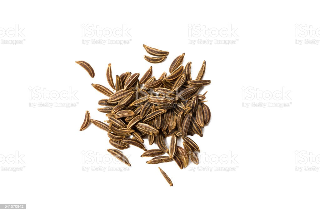 Caraway seed isolated on white, view from above. stock photo