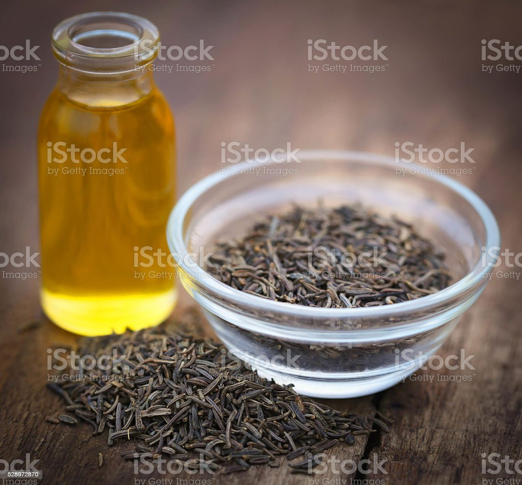Caraway seeds with essential oil stock photo