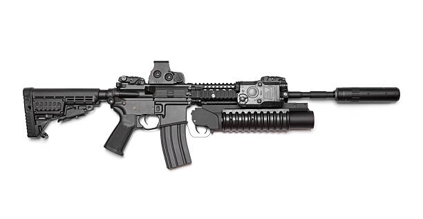 AR-15 (M4A1) carbine isolated on white background. Weapon Series. AR-15 (M4A1) carbine with holographic sight, M203 grenade launcher and sound suppressor. Isolated on a white background. Right side view. Studio shot ar 15 stock pictures, royalty-free photos & images