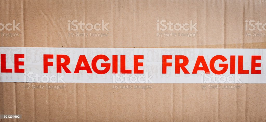 Carboard box with fragile tape stock photo
