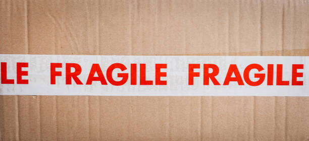carboard box with fragile tape - fragile stock pictures, royalty-free photos & images
